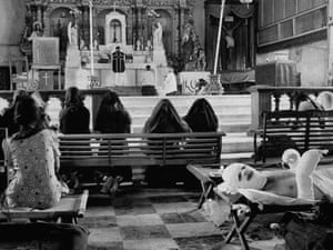 Black-veiled Filipino women kneeling in the cathedral, Leyte, Philippines
