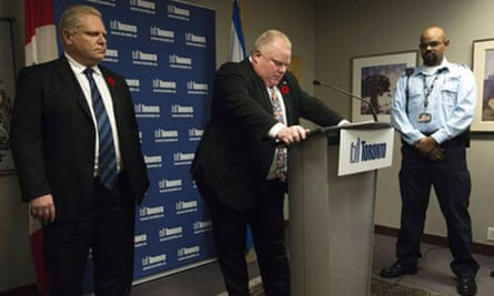 Rob Ford, watched by his brother Rob