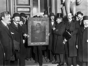 People gather around the Mona Lisa painting in Paris, France, in January 1914