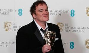 Django Unchained writer/director Quentin Tarantino holds his Bafta for best original screenplay