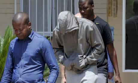 Oscar Pistorius leaving Boshkop police station