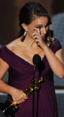 Natalie Portman accepts her award for best actress in 2011