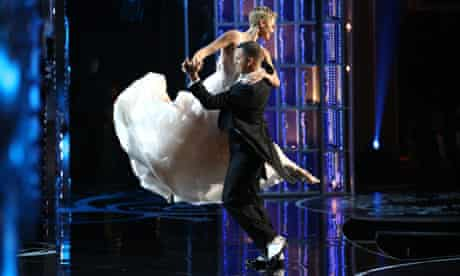 Channing Tatum and Charlize Theron dancing at the 86th academy awards