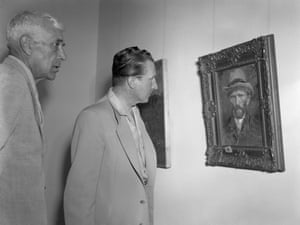 French painter Georges Braque with the art dealer Aime Maeght looking at a Van Gogh self-portrait