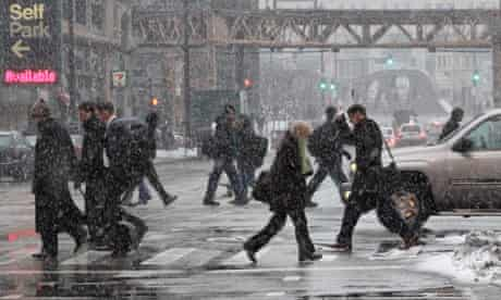 Commuters brave the elements on their way to work.