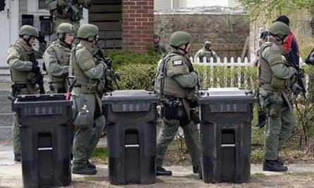 Swat team search homes in Watertown, Boston