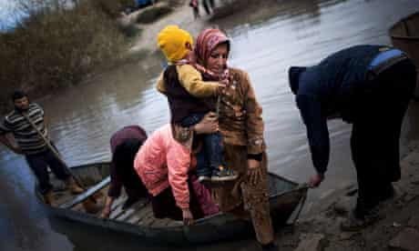 Syrian refugees cross from Syria to Turkey via the Orontes River, December 2012