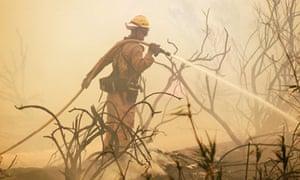 Firefighter battles wildfire near Point Mugu, California