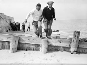 Joe Louis Running with Trainer on the Michigan side of Lake Michigan