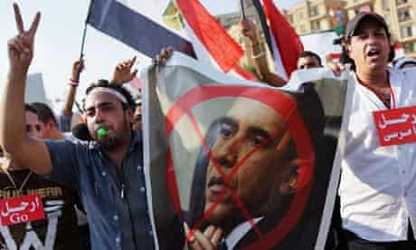 Egypt protesters carry anti-Obama posters