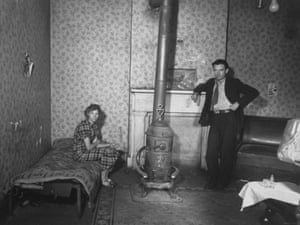 A young couple by the stove in their tenement, Hamilton County, Ohio. 1936