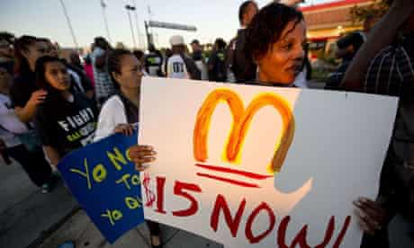 Fast food workers and their supporters picket outside a Burger King in Los Angeles