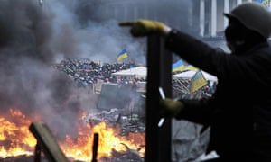 Protesters stand on barricades in Kiev