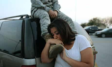 Soldier and his wife wait to return to their home on Fort Hood army base