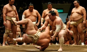 Asashoryu throws and opponent during a sumo bout in Tokyo
