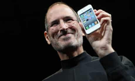 File phot of Apple CEO Steve Jobs posing with the new iPhone 4 in San Francisco