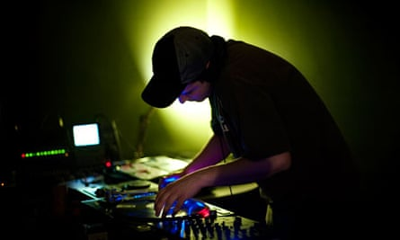 DJ spinning records at party