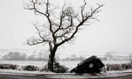 A Range Rover lies in a ditch