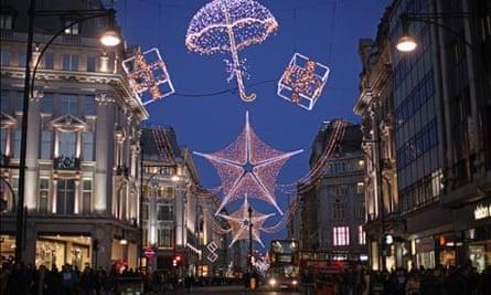 christmas shoppers beneath the Oxford Street lights, London