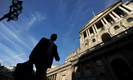 A man walks past the Bank of England