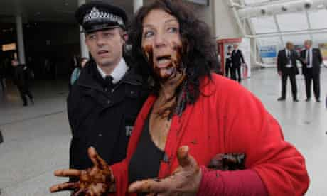 Protester Diane Wilson outside BP's annual meeting, covered in an oil-like substance.