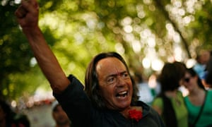 Demonstrator on a march marking the Carnation Revolution's 37th anniversary in Lisbon