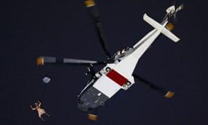 Actors portraying the Queen and James Bond arrive via parachute