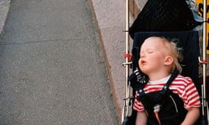 toddler asleep in a pushchair