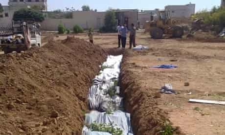 mass burial for the victims whom activists said were killed by forces loyal to Syria's president