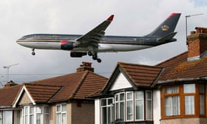A Royal Jordanian airways jet arrives over the top of houses to land at Heathrow Airport