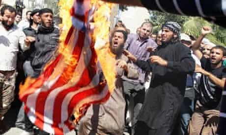 Islamist Salafis set fire to a U.S. flag in Amman