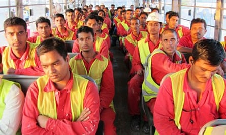 A bus carries migrant workers to begin their shift at the Saadiyat Island site in Abu Dhabi.