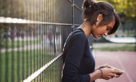 Teenage girl sending text message