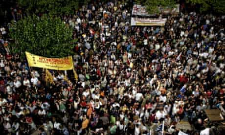 Protesters gather in front of the Greek