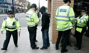police perform a stop and search in harrow uk