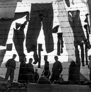 Great press photography: captured soldiers are surrounded by textile phantoms in South Korea
