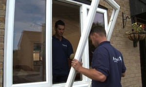 Double glazing being fitted to reduce heat loss