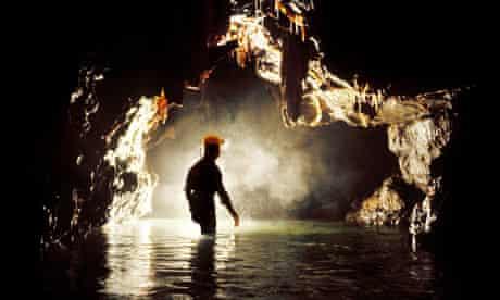 Caver in Llygad Llwchwr a river cave in South Wales UK