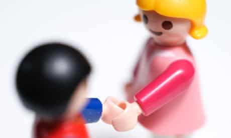 Two child's toys shaking hands