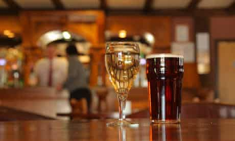 Close up of a glass of wine and pint of beer
