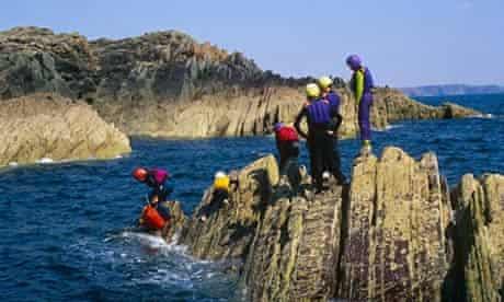 Wales, Pembrokeshire. Coasteering along the Pembrokeshire coast.