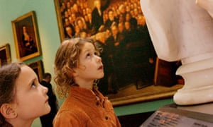 children looking up at ancient busts