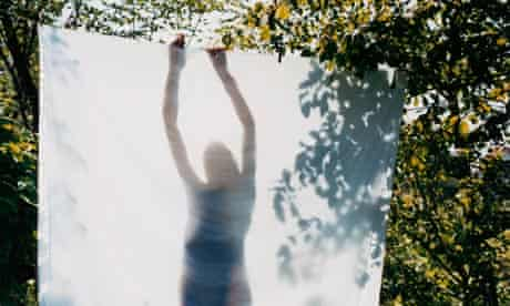 A woman hanging up some washing