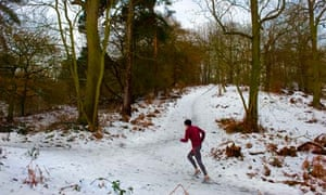 A person running through snow in Coombe Wood in Essex.  Photo by Gordon Scammell