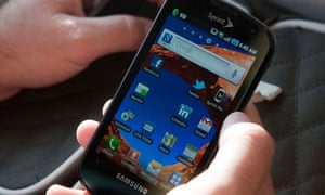 A man holds a Sprint Samsung Galaxy S Android phone Tuesday August 2, 2011.