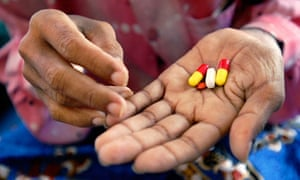 29-year-old Poeun Pech, an HIV positive mother of two boys, holds her cocktail of ARVs at a hospital