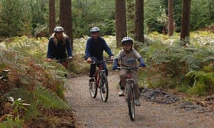 A family cycling at Haldon Forest Park, near Exeter