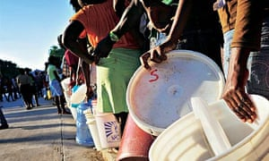 Locals queue for water after the Haiti earthquake