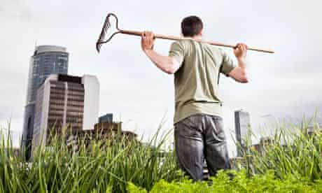 Urban gardening - man with rake
