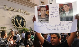 Egyptian protester with portraits of Mohamed Bouazizi and Khaled Said